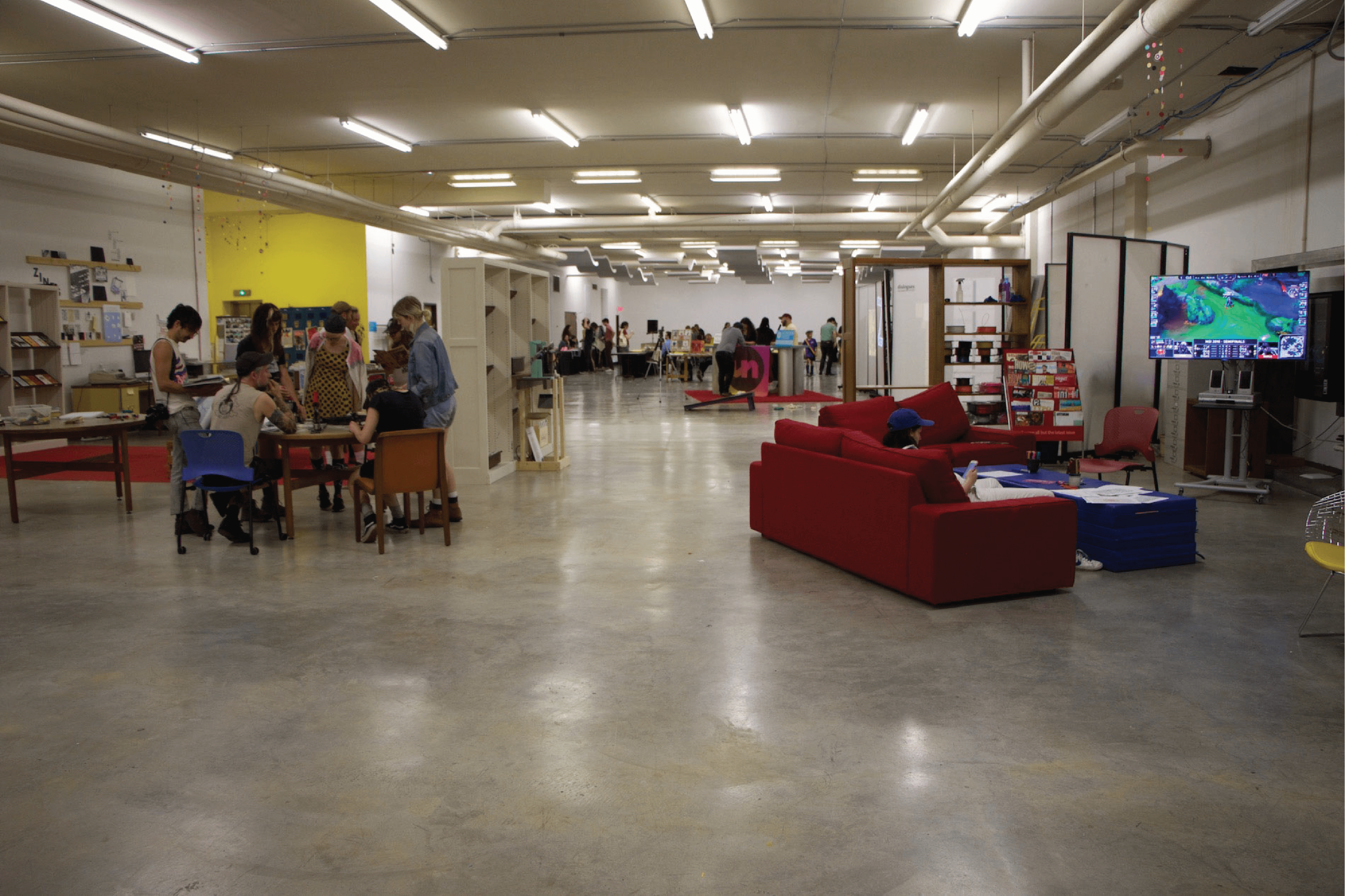 Pictured is the 4th floor of the Chattatnooga PUblic library with several people taking part of various activities